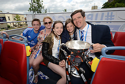 Bristol Rovers Manager, Darrell Clarke poses with his family with the Vanarama Conference Play-Off Final trophy  - Photo mandatory by-line: Dougie Allward/JMP - Mobile: 07966 386802 - 25/05/2015 - SPORT - Football - Bristol - Bristol Rovers Bus Tour