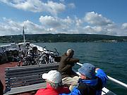 Personen und Fahrräder auf Fähre, Bodensee, Baden-Württemberg, Deutschland.| .bicycle and passenger ferry, Lake Constance, Germany