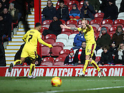 Burnley midfielder Scott Arfield celebrating scoring first goal with Burnley striker Andre Grey during the Sky Bet Championship match between Brentford and Burnley at Griffin Park, London, England on 15 January 2016. Photo by Matthew Redman.