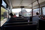 Passengers inside top deck of double decker bus