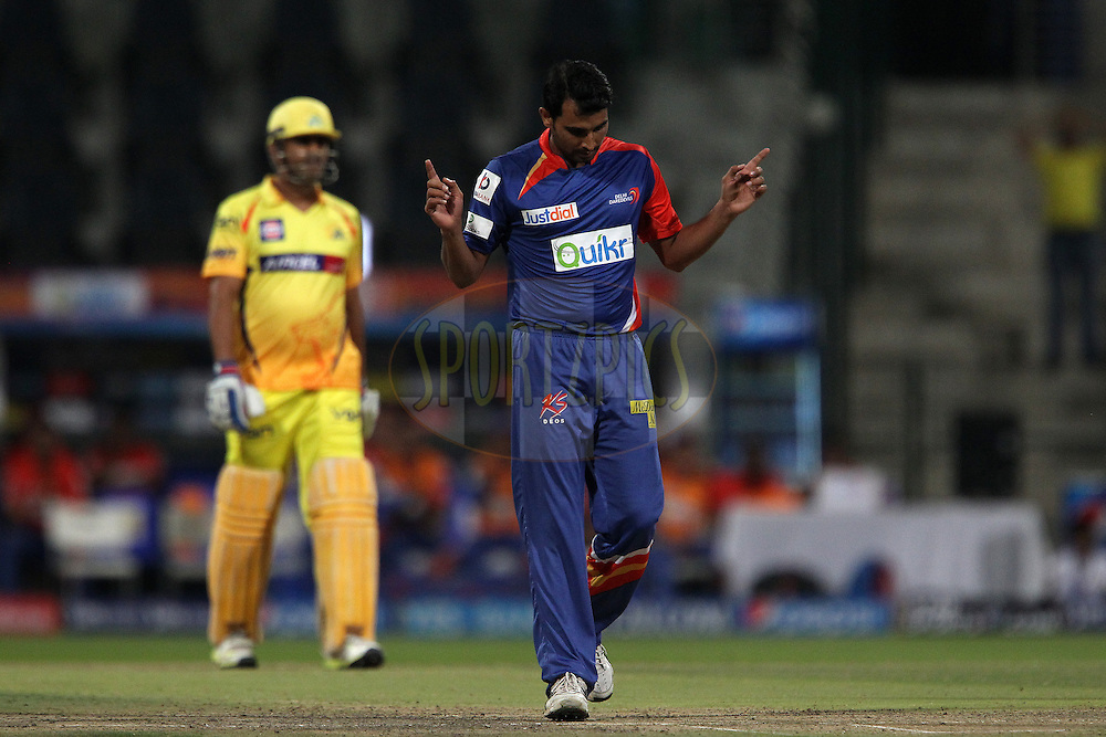 Mohammad Shami of the Delhi Daredevils celebrates the wicket of Faf du Plessis of The Chennai Superkings during match 8 of the Pepsi Indian Premier League 2014 between the Chennai Superkings and The Delhi Daredevils held at the Zayed Cricket Stadium, Sharjah, United Arab Emirates on the 21st April 2014<br /> <br /> Photo by Ron Gaunt / IPL / SPORTZPICS