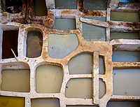FEZ, MOROCCO - CIRCA MAY 2018: Dye pools at the Chouara Tannery in Fes.  Built in the 11th century, it is the largest tannery in the city. It is located in the Fes el Bali, the oldest medina quarter of the city,