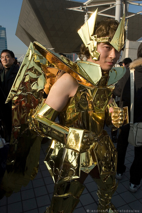 "Cosplayer dressed as ""Sagitarius"", character from the action game ""SAINT SEIYA"".  TOKYO COMIC MARKET ""COMIKET"" the biggest comic market in Japan. Independent designers come to sell their comics, there is anime, manga, cosplay, toys, posters etc. At ""Tokyo Big Sight"" exhibition center."