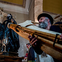 01/05/2017 The ritual of Serpari, Cocullo, Abruzzo Region, Italy<br /> Every year on May 1st in Cocullo the feast of Saint Domenico and snakes.<br /> The ritual of Serpari, also known as the procession of Serpari, is held every year on May 1st in Cocullo, a small village in the province of L&rsquo;Aquila, to celebrate the feast of the abbot Saint Domenico. According to tradition Saint Domenico, an abbot and a Benedictine monk who lived in Cocullo for 7 years, is the saint that protects from toothache, from anger an from snakebites. The ritual starts the month before when the &ldquo;serpari&rdquo; hunt snakes. During the celebration day, the statue of Saint Domenico is carried in the procession and decorated with the snakes which, at the end of the feast, are set free in their natural habitat. The Serpari allow the visitors to touch and handle the snakes before the procession, which is combined with popular songs while they wander in the village streets.<br /> The next day the snakes will be released in the same place they were caught.
