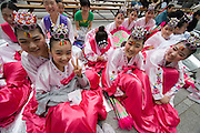 The annual Lotus Lantern Festival is held to celebrate Buddha's Birthday. Traditional fan dancers.