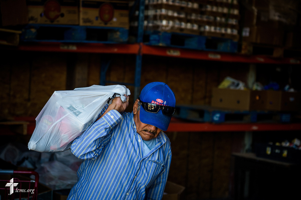 A volunteer carries a bag of food for distribution on Saturday, May 21, 2016, at  Ysleta Lutheran Mission Human Care in El Paso, Texas. LCMS Communications/Erik M. Lunsford