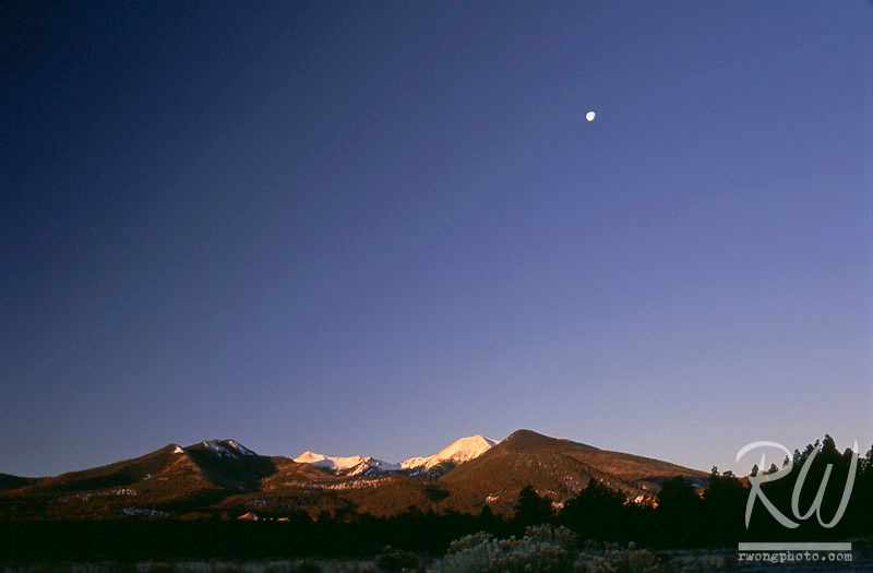 Sunrise Moon over San Francisco Peaks, Sunset Crater Volcano National Monument, Arizona
