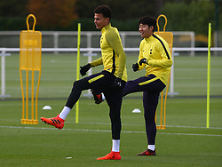 October 31, 2017 - Enfield, England, United Kingdom - L-R Tottenham Hotspur's Dele Alli and Tottenham Hotspur's Son Heung-Min.during a Tottenham Hotspur training session ahead of the UEFA Champions League Group H match against Real Madrid  at Tottenham Hotspur Training centre on 31 Oct , 2017 in Enfield, England. (Credit Image: © Kieran Galvin/NurPhoto via ZUMA Press)