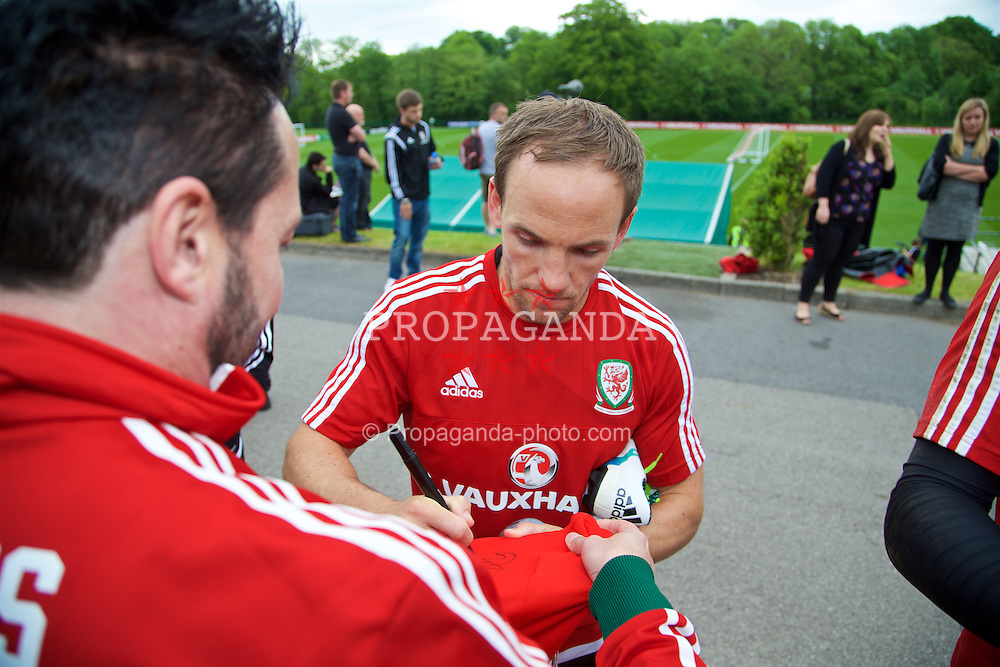 CARDIFF, WALES - Wednesday, June 1, 2016: Wales' David Vaughan signs autographs for supporters after a training session at the Vale Resort Hotel ahead of the International Friendly match against Sweden. (Pic by David Rawcliffe/Propaganda)