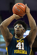 FORT WORTH, TX - JANUARY 4: Devin Williams #41 of the West Virginia Mountaineers shoots a free-throw against the TCU Horned Frogs on January 4, 2016 at Ed and Ray Schollmaier Arena in Fort Worth, Texas.  (Photo by Cooper Neill/Getty Images) *** Local Caption *** Devin Williams