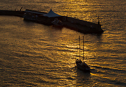 Sorrento, Italy, September 20 2017. A boat enters Marina Piccolo at sunset in Sorrento, Italy. © Paul Davey