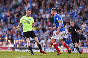 Portsmouth Defender, Matt Clarke (5) tackles Peterborough United Midfielder, Marcus Maddison (11) during the EFL Sky Bet League 1 match between Portsmouth and Peterborough United at Fratton Park, Portsmouth, England on 5 May 2018. Picture by Adam Rivers.