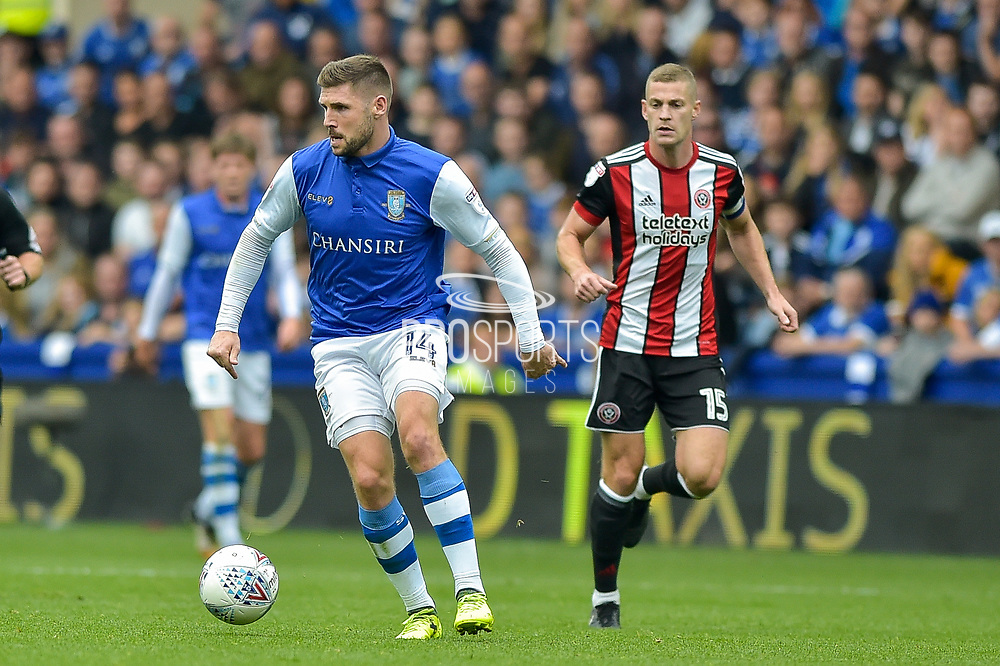 Sheffield Wednesday forward Gary Hooper (14) gets away from Sheffield United midfielder Paul Coutts (15) during the EFL Sky Bet Championship match between Sheffield Wednesday and Sheffield Utd at Hillsborough, Sheffield, England on 24 September 2017. Photo by Adam Rivers.