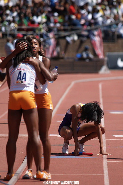 Brittaney Sheffey of the University of Tennessee, facing the camera, celebrates with her teammate Chanelle Price as LaTavia Thomas of LSU squats down exhausted following the College Women's 4x800 Championship of America at the Penn Relays athletic meet on Saturday, April 24, 2010 in Philadelphia, PA.