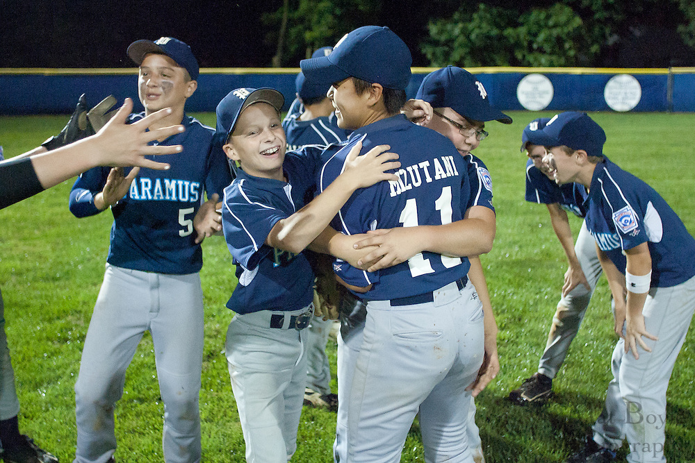 Paramus players celebrate winnging the NJ Little League State Tournament finals over Erial held in Williamstown Wednesday.