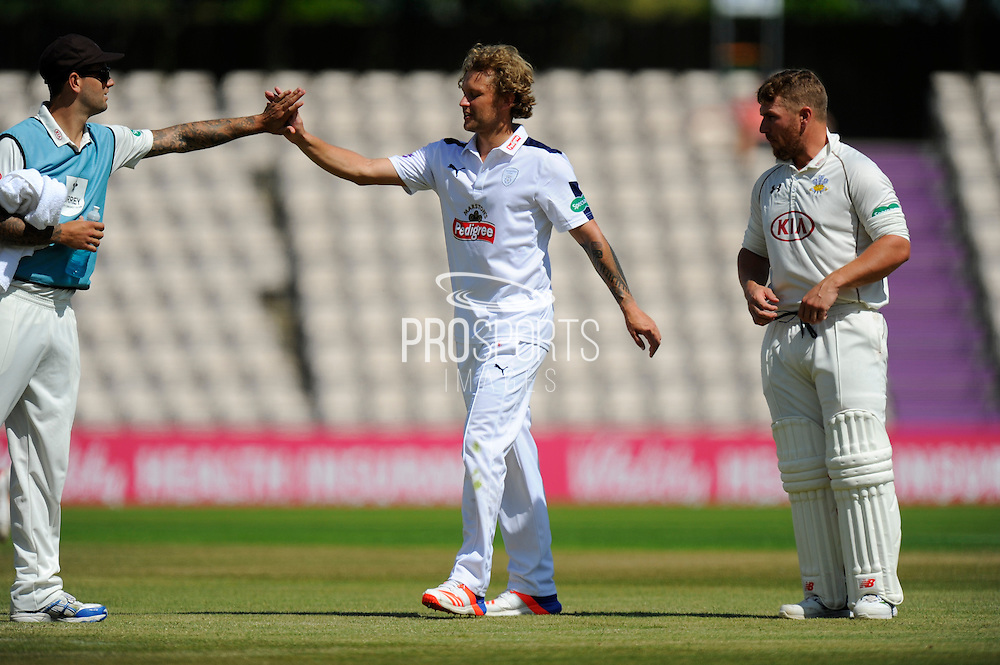 Hampshire's Gareth Berg celebrates taking the wicket of Surrey's Steven Davies during the Specsavers County Champ Div 1 match between Hampshire County Cricket Club and Surrey County Cricket Club at the Ageas Bowl, Southampton, United Kingdom on 18 July 2016. Photo by Graham Hunt.