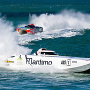 Maritimo 1 and Hogs Breath round a turn marker, Inboard Engine Class, in the Offshore Superboat Championships Coffs Harbour, New South Wales, Australia