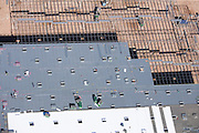 Skylights project light through the roof of this new industrial building under construction.  Day lighting saves energy by reducing electricity costs for lighting.