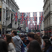 Union Jacks flying in Coventry Street near Piccadilly Circus in London City centre as London prepares for the  London 2012 Olympic games, UK. 14th July 2012. Photo Tim Clayton