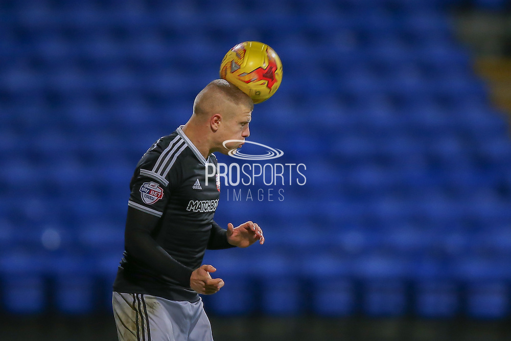 Brentford defender Jake Bidwell  with a header during the Sky Bet Championship match between Bolton Wanderers and Brentford at the Macron Stadium, Bolton, England on 30 November 2015. Photo by Simon Davies.