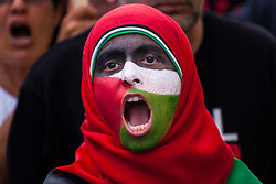 London, August 1st 2014. A woman has her face painted with the Palestinian flag as thousands of Palestinians and their supporters protest in London outside the Israeli Embassy following the collapse of the 72 hour ceasefire in the ongoing conflict as Israel's Operation Protective Edge in Gaza seeks to eradicate Hamas tunnels and stop rocket attacks.