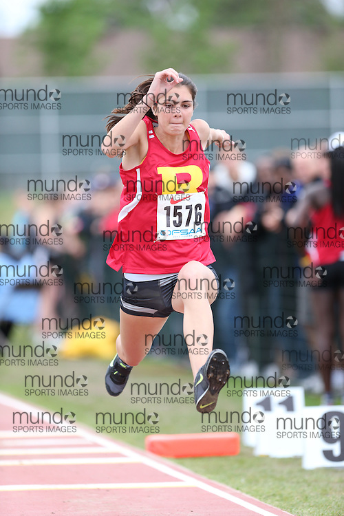 Jordan Bates of Richview CI - Islington competes in the senior girls triple jump at the 2013 OFSAA Track and Field Championship in Oshawa Ontario, Thursday,  June 6, 2013.<br /> Mundo Sport Images / Sean Burges