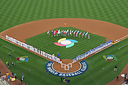 LOS ANGELES, CA - MARCH 21: General view from overhead as flag bearers carry the flags of the 16 competing teams while the Korea team (blue uniforms) gets ready to play against Venezuela (white uniforms) during game one of the semifinal round of the 2009 World Baseball Classic at Dodger Stadium in Los Angeles, California on Saturday March 21, 2009. Korea defeated Venezuela 10-2. (Photo by Paul Spinelli/WBCI/MLB Photos)