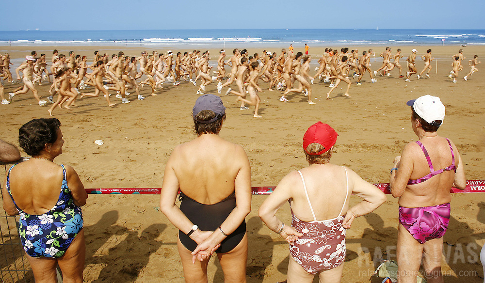 A group of elder women attend the Patxi Ros nudist cross-country race, 15 September 2007, in the northern Spanish Basque village of Sopelana's beach. PHOTO RAFA RIVAS
