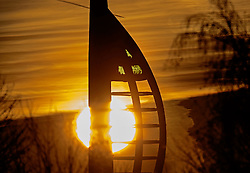© Licensed to London News Pictures. 01/12/2016. Portsmouth, UK. The sun rises behind the Spinnaker Tower on the first day of December. Another day of freezing temperatures is forecast for today. Photo credit: Peter Macdiarmid/LNP