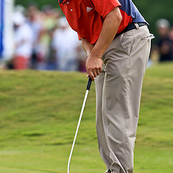 2009 April 26: Charley Wi of Westlake Village, CA putts on the 18th hole during the final round of the Zurich Classic of New Orleans PGA Tour golf tournament played at TPC Louisiana in Avondale, Louisiana.