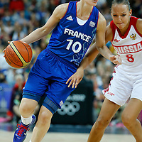 09 August 2012: France Florence Lepron drives past Russia Alena Danilochkina during 81-64 Team France victory over Team Russia, during the women's basketball semi-finals, at the 02 Arena, in London, Great Britain.