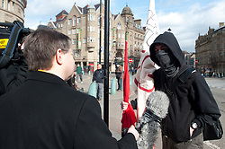 BBC news crew interview a demonstrator outside the Liberal Democrat party Conference in Sheffield Friday Afternoon.11 March 2011.Images © Paul David Drabble