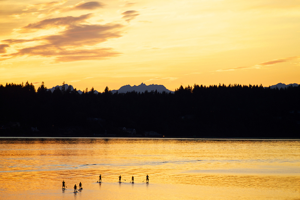 Sunset with SUP paddlers on Puget Sound with the Olympic mountains in the background