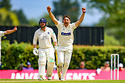 Wicket ..George Scott of Middlesex bowled out by Lukas Carey of Glamorgan who celebrates during the Specsavers County Champ Div 2 match between Middlesex County Cricket Club and Glamorgan County Cricket Club at Radlett Cricket Ground, Radlett, Herfordshire,United Kingdom on 17 June 2019.