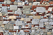 an old wall with bricks and flint stones