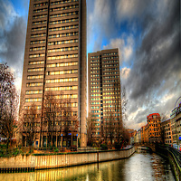 Surreal HDR of Berlin city, shot early evening, Communist flats reflecting in the canal in Mitte.