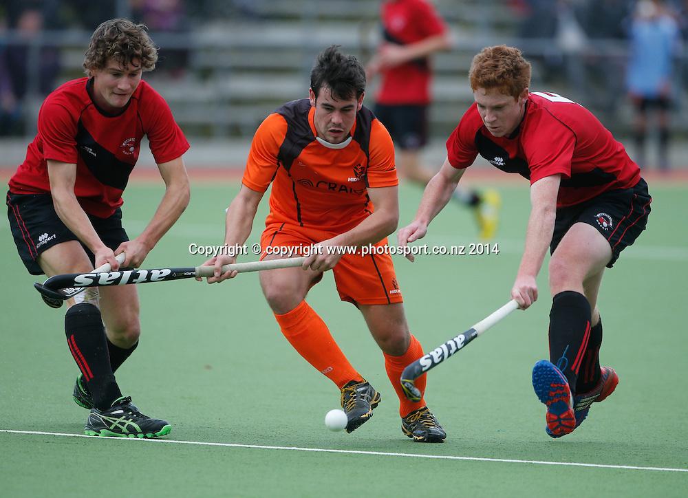 Midland's Hamish McGeorge looks for a way through the defence. Canterbury v Midlands, Final - National U18 Regional Hockey Tournament, Napier, New Zealand. Saturday, 12 July, 2014. Photo: John Cowpland / photosport.co.nz