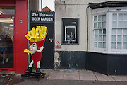 A cartoon character promoting chips outside the now vacant Britannia pub on the Eastern Esplanade at Southend-on-Sea, Essex.