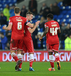 Cardiff City's Joe Ralls celebrates his goal with Cardiff City's Ben Turner and Cardiff City's Kadeem Harris - Photo mandatory by-line: Dougie Allward/JMP - Mobile: 07966 386802 - 02/01/2015 - SPORT - football - Cardiff - Cardiff City Stadium - Cardiff City v Colchester United - FA Cup - Third Round