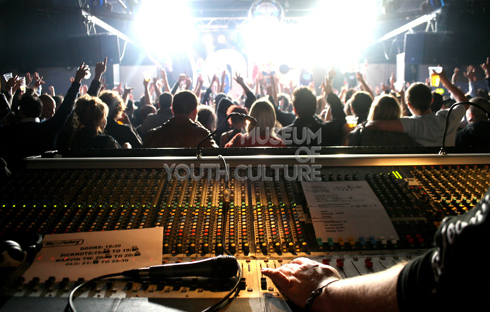 The mixing desk and crowd at a gig, Wales, UK 2006
