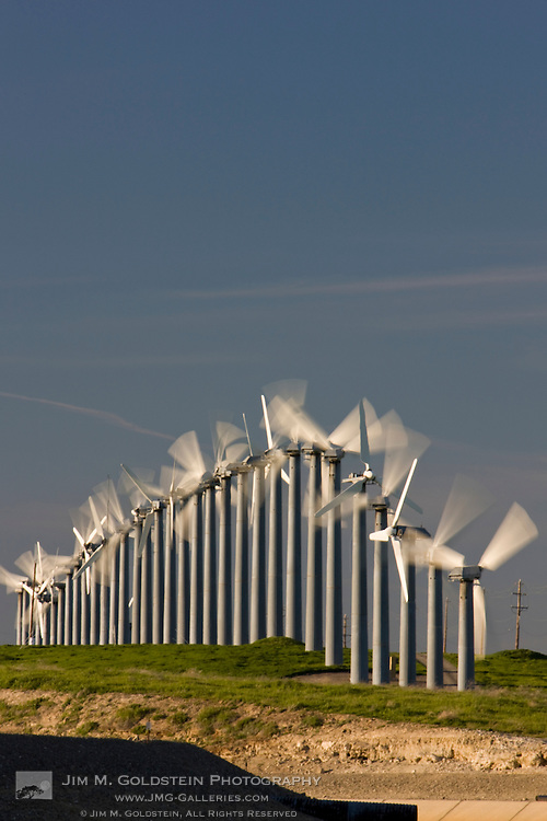 Renewable energy through wind power is collected via wind turbines in northern California's Altamont Pass.