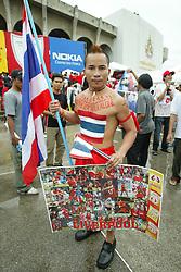 BANGKOK, THAILAND - Thailand. Thursday, July 24, 2003: A Thai Liverpool fan outside the Rajamangala National Stadium before Liverpool's preseason friendly match against Thailand. (Pic by David Rawcliffe/Propaganda)