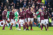 Correction: Christophe Berra (#6) of Heart of Midlothian and Don Cowie (#15) of Heart of Midlothian celebrates Heart of Midlothian's first goal (1-0) during the William Hill Scottish Cup 4th round match between Heart of Midlothian and Hibernian at Tynecastle Stadium, Gorgie, Scotland on 21 January 2018. Photo by Craig Doyle.
