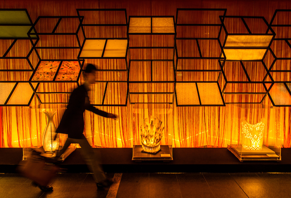 A man walks past an art installation at the NHK Building in Sakae, Nagoya, Japan.