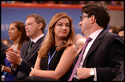 Image ©Licensed to i-Images Picture Agency. 29/09/2014. Birmingham, United Kingdom.  karren Brady talks to Andrew Feldman while watching Chancellor of the Exchequer George Osborne <br /> deliver his keynote speech on  Day 2 of the Conservative Party Conference at the ICC Birmingham. Picture by Andrew Parsons / i-Images