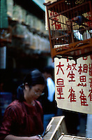 A woman working at the Yuen Po Street Bird Garden in Kowloon, Hong Kong, China.