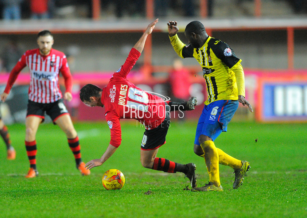 Exeter City's Lee Holmes and Dagenham & Redbridge's Clevid Dikamona during the Sky Bet League 2 match between Exeter City and Dagenham and Redbridge at St James' Park, Exeter, England on 2 January 2016. Photo by Graham Hunt.