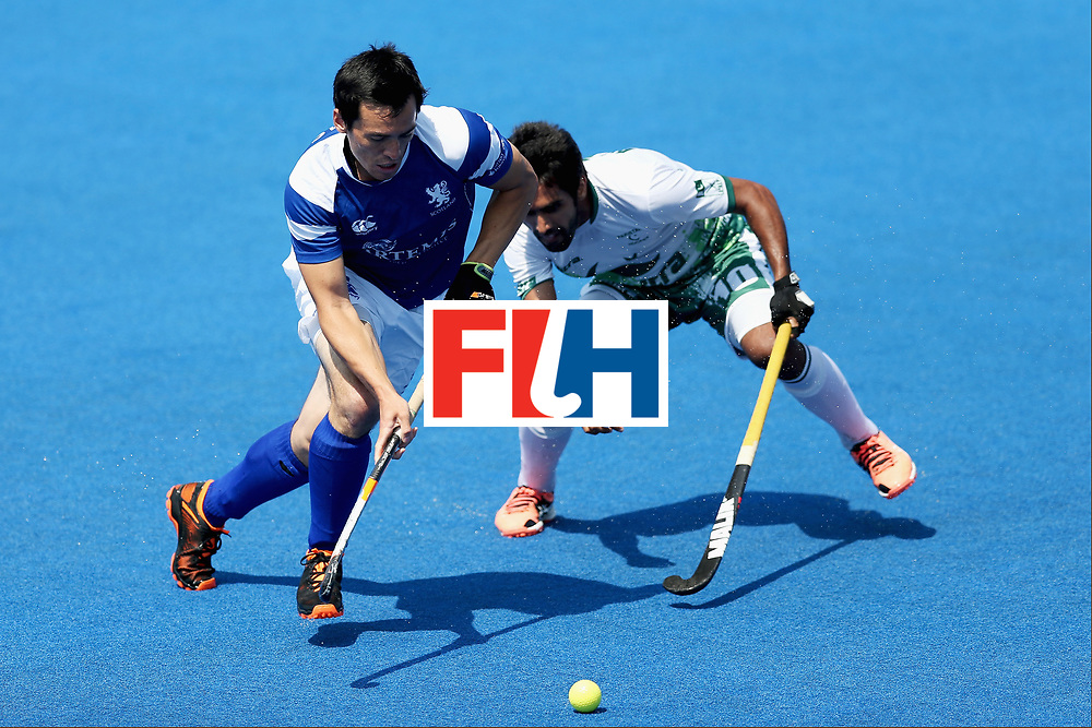LONDON, ENGLAND - JUNE 19: Wei Adams of Scotland and Ali Shan of Pakistan battle for possession during the Pool B match between Scotland and Pakistan on day five of Hero Hockey World League Semi-Final at Lee Valley Hockey and Tennis Centre on June 19, 2017 in London, England.  (Photo by Alex Morton/Getty Images)