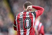 Billy Sharp (Captain) (Sheffield United) points to his name for the away supporters as he walks away from them having scored for Sheffield United to make it 1-0 to the home team during the EFL Sky Bet League 1 match between Sheffield Utd and Bolton Wanderers at Bramall Lane, Sheffield, England on 25 February 2017. Photo by Mark P Doherty.