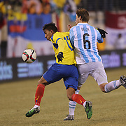 Angel Mena, (left), Ecuador and Lucas Biglia, Argentina,  challenge for the ball during the Argentina Vs Ecuador International friendly football match at MetLife Stadium, New Jersey. USA. 31st march 2015. Photo Tim Clayton